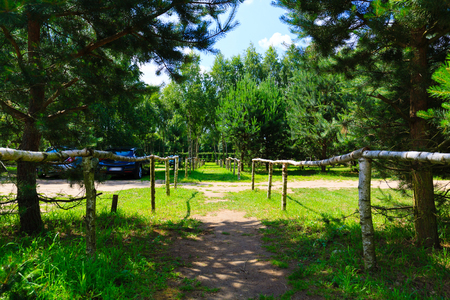 roped: Forest parking with path roped barriers.