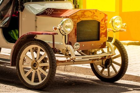 The front of old vintage car with shining bumper and reflector.