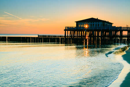 morskie: Restaurant at wooden pier on the Baltic sea during sunrise. Ustronie Morskie, Poland. Stock Photo