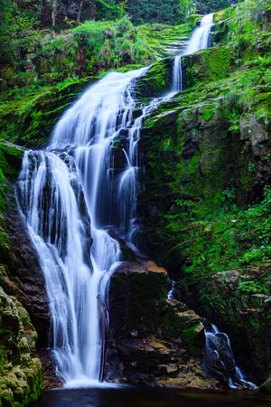Kamienczyk Waterfall in Giant Mountains National Park in Poland Sudeten Mountains near Szklarska Poreba town. Stock Photo
