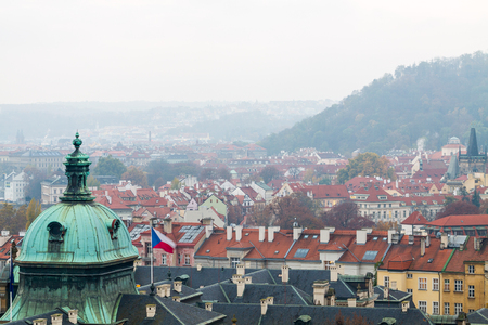 Prague rooftops panorama with the Straka Academy in front.