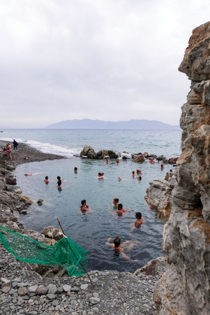 Greece, Kos Embros Thermae, 08 May 2017: People take a health bathwater at Kos Thermal Springs.