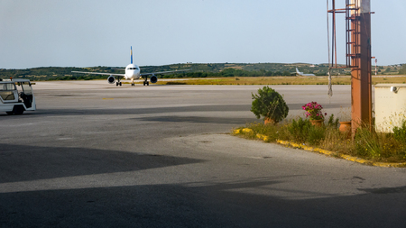 turboprop: Front view of plane stay in small airport.