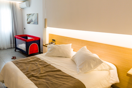 luxury apartment: Hotel room with bed and remote tv. Stock Photo