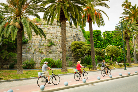 Bikers on bicycle path in Kos town in Greece.