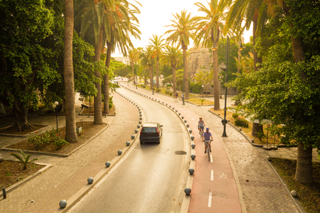 Cycle path near Neratzia Castle and ferry terminal in Kos Greece, with palm trees in sunny day.