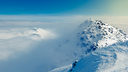 tatra: Chopok peak on snowy winter time, above the clouds. Stock Photo