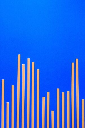 Concept background of fettuccine pasta looks like amplitude graph. Stock Photo