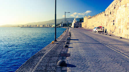 Road in Kos town near Neratzia Castle and port. Stock Photo