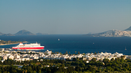 Big red and white ferry boat of the coast Kos island, Greece. Stock Photo