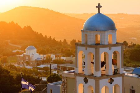 Kos 섬 그리스에서 Asfendiou 마을에서 교회 종탑과 함께 일몰보기 스톡 콘텐츠