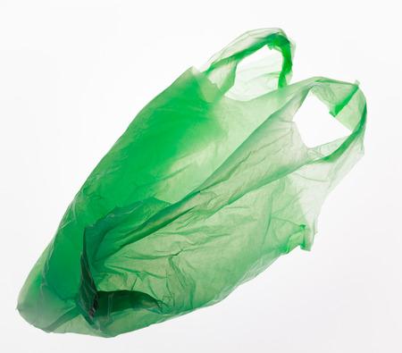 Green plastic bag isolated on white. Standard-Bild