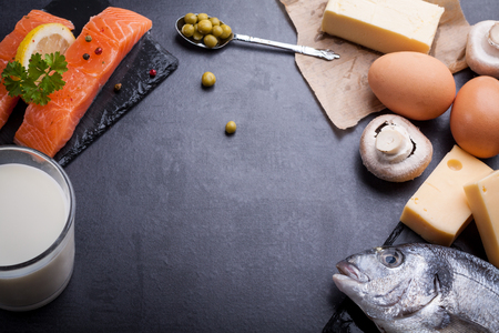Black table with ingredients of food rich in vitamin D and omega 3, with copy space. Standard-Bild