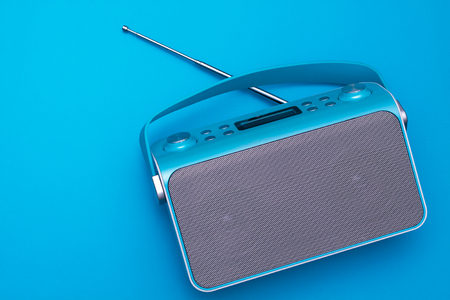Top view on new digital blue radio,which it is stylized art retro style radio.