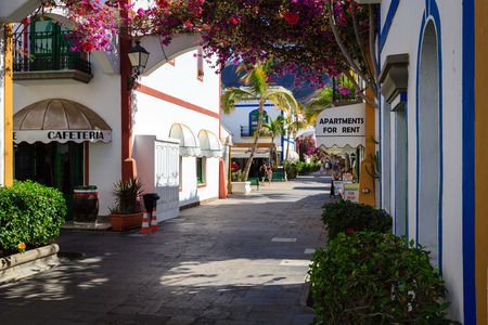 Wonderful alley with colorful flowers, doors and windows in Puerto De Mogan on Gran Canaria island. Editorial