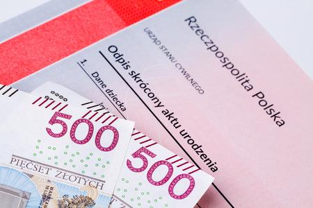 Five hundred polish zloty on birth certificate, concept of polish social program named 500 plus.