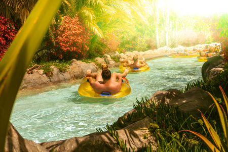 People floating on lazy river in Siam Park, Tenerife, Spain. Stock Photo
