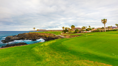 Golf course along rocky coastline. Tenerife, Spain.