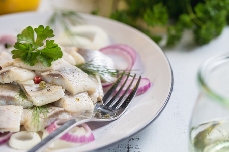 Plate of herring with oil and onion, greek style food.