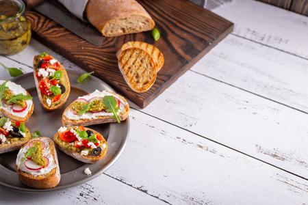 Fresh and crispy Italian snack like bruschetta or crostini. Stock Photo