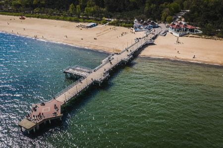 Aerial view on Gdansk Brzezno pier with many people.