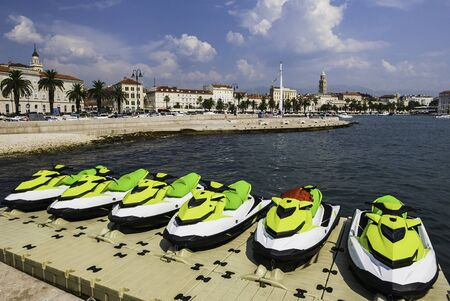 Jet skis docked on floating pontoon in Croatia, holiday destination. Imagens