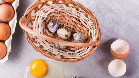 Chicken and quail eggs with basket.