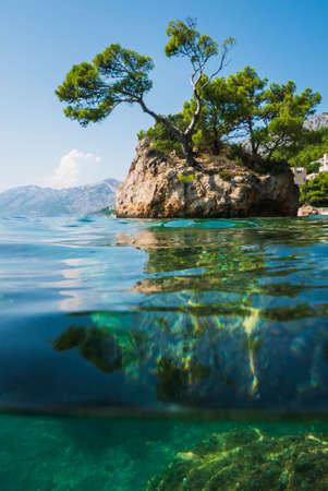 Semi underwater photography of holiday resort Brela in Croatia, famous Brela Rock, Punta Rata Beach, Makarska Riviera.