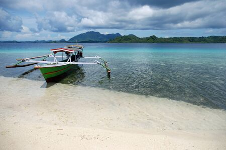 Indonesian boat on the beach Stock Photo - 15951961