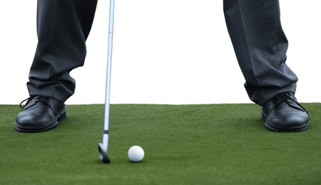 golf stance on green carpet Stock Photo