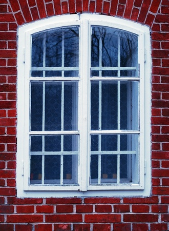 old white window with red bricks Stock Photo