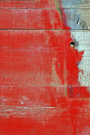 background of red planks, flaking paint