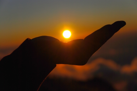 yellow sun in the palm of your hand Stock Photo - 16815805