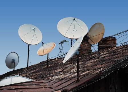 parabolic mirror: Full roof antennas, and satellite television signal is everywhere