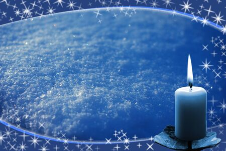 blue frame from white flakes and candle, blue magic background photo