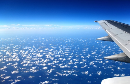 view from the airplane window, ocean blue