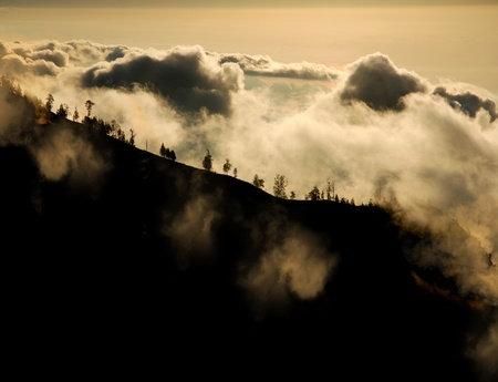 rise above: view of the mountains rise above the clouds at sunset Stock Photo