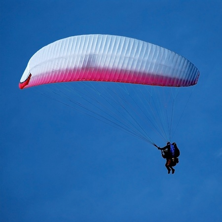 tandem paragliding in the blue sky, flying in the sky