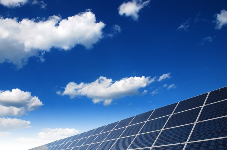 solar power: solar power station under blue sky, panels producing electricity