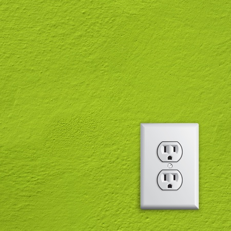 grounded plug: simple white electric usa socket on green wall Stock Photo