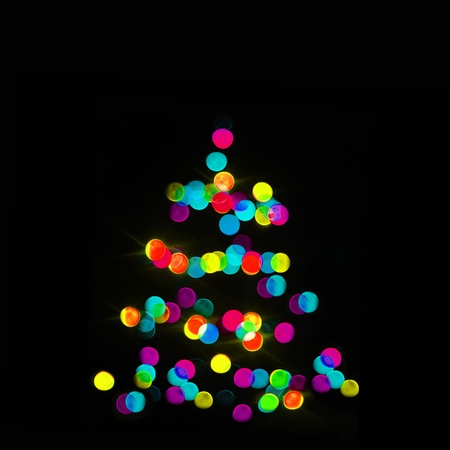 xmas tree: colorful strings of Christmas tree lights on the black background Stock Photo