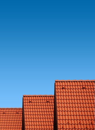 roof with red tiles with blue sky, new roof Stock Photo