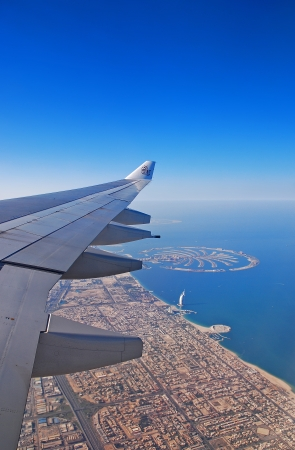 view from the aircraft to the Dubai skyline city Stock Photo