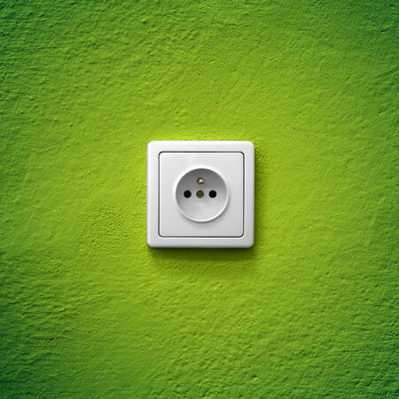 Green power socket simple white electric socket on green wall