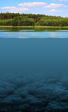 Look under the surface of the lake, between two worlds Stock Photo