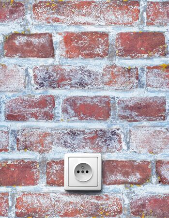 old red brick wall with electrical outlet