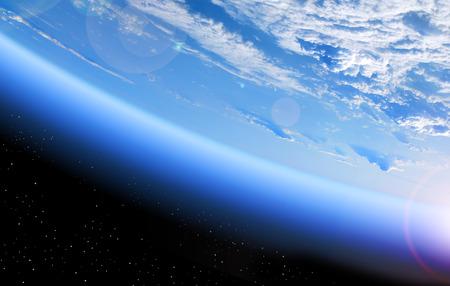 空間、青い惑星と深い黒の空間から地球のビュー 写真素材