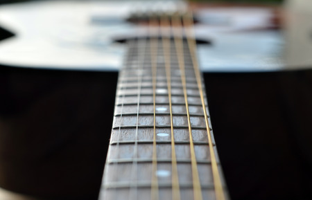 Guitar background, sounding strings on white background Stock Photo