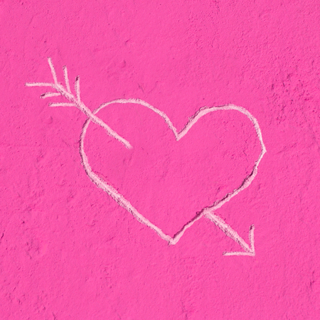 Heart of Love, carved into the pink wall Stock Photo