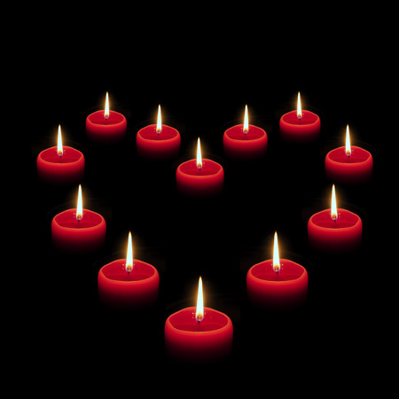 Heart symbol composed of burning red candles Stock Photo